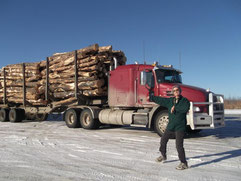 Kelly in front of her rig. Hauling a load of logs with the Mack truck.