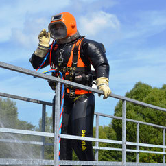 diver-in-diving suit-is- splashed-with water
