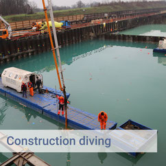 construction-divers-on-floating-pontoons