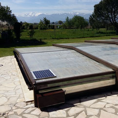 Low, flat telescopic swimming pool enclosure motorised with AKIA wheeled motor drives