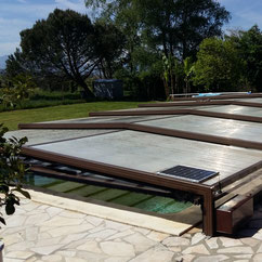 Swimming pool enclosure motorised with AKIA wheeled automation equipment