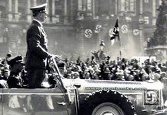 Hitler driving into here square Vienna March 1938