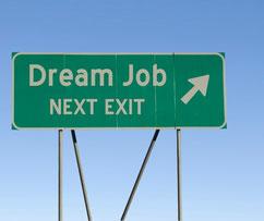 """Panneau de circulation indiquant """"Job de rêve, prochaine sortie""""."""