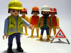 Bild Personal Coaching für Firmen Teamcoaching für Fach- und Führungskräfte, Männchen vor Baustelle