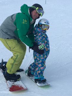 Kids snowboard lessons, Val d'Isere, beginner, first time on snowboard,