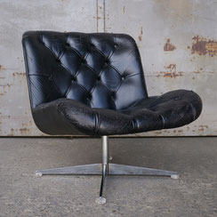 drehbarer Ledersessel schwarz Chromgestell Krähenfuß vintage 70er Jahre