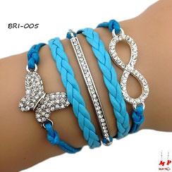 Bracelet infini bleu avec papillon, barre et infini en strass