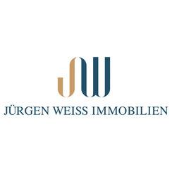 Farbiges Logo von Weiß Immobilien an der Stübeheide