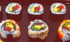 Traditional sushi rolls and inside-out sushi
