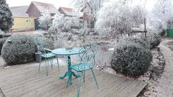 Ferienhäuser Aura - winterlicher Garten