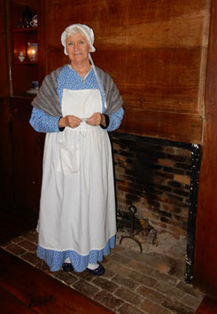 A Costumed Interpreter by the Hearth