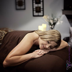 Relaxing massage in the comfort of your own home in St Albans area woman happy destressing