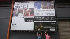 Lifting the big advertising board in Kota Kinabalu
