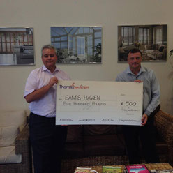 Managing Director, Nigel Campkin presents a cheque to Paul