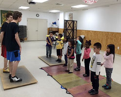Students at CentroNia preschool learning basic tap steps