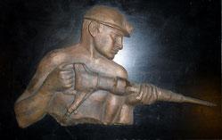 Bergmann mit Abraumhammer