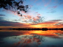 Sonnenaufgang über dem Okavango