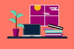 デスクのうえに広げられた書籍。見開きページでハート形。