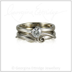 Ring Shaped to fit asymmetrical shaped engagement ring
