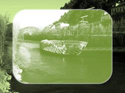 In grün abgebildete Grazer Murinsel mit Blick auf den Kai - Brandschutzkonzepte und Bauplanung