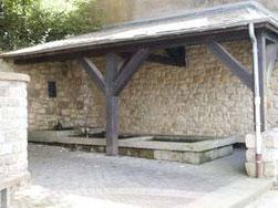 Der restaurierte Waschbrunnen