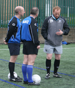 Daz (right) in deep discussion with a Management Team