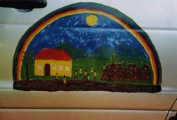 Das symbolische Gemälde von Entwicklungshelferin Ine Scheidecker schmückt die Tür des Zubringers.