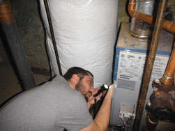 Inspecting a furnace in Ann Arbor