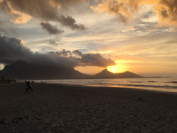 An image showing the sun setting over signal point in cape town