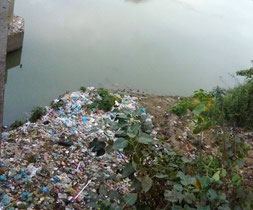 Small river in Yangon, carrying all kind of garbage.