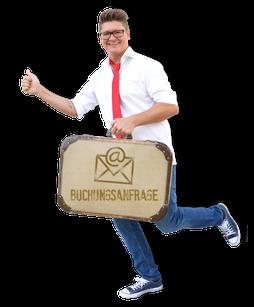 lustiger Zauberer Gabriel mit Koffer für Buchungsanfragen