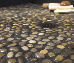 Multicolor pebble shower pan with dark grout