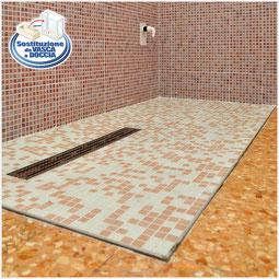 Soluzione doccia a filo pavimento per accesso facile con carrozzina  + box a vetro