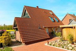Ferienhaus Waldhaus mit Strandkorb in Kellenhusen