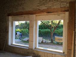 ouverture d'une fenêtre dans un mur