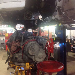 Replacing a car engine in the CMR Rebuild shop