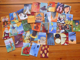 """Auswahl von Bildkarten aus dem DaF-Spiel """"Dixit"""""""