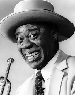 Louis Armstrong, AS en Bélier, Soleil en Lion.