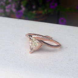 A 1.59 carat Trillion-cut diamond set into a custom-made 14K Rose Gold mounting.