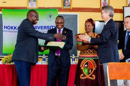 (from the left)Dr. Victor C. Zulu, Prof. Luke E. Mumba, Prof. Enala T. Mwase, Prof. Ichiro Uyeda, Mr. Yuzo Nabae