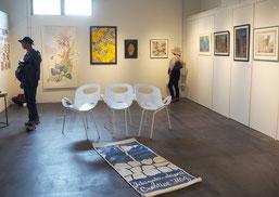 石垣島クリエイティブフラッグの合同展が開催されている=13日、ホテルエメラルドアイル石垣島ギャラリー