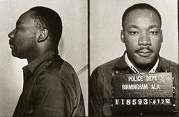 Мартин Лютер Кинг во время ареста в Бирмингеме