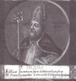 """Hezilo als 17. Bischof von Hildesheim auf einem Gemälde mit Medaillondarstellungen aller Hildesheimer Bischöfe bis zum Ende des 18. Jahrhunderts; lateinische Inschrift: """"Er baute den vom Feuer zerstörten höchsten Tempel; er errichtete die Kirche des hl. M"""