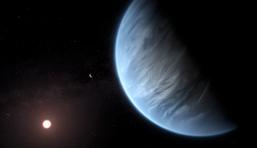 Esta recreación artística muestra el planeta K2-18b, su estrella anfitriona y un planeta acompañante. Imagen: ESA / Hubble / M. Kornmesser