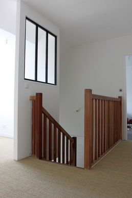 The sunny landing serves the two upstairs bedrooms and a mezzanine that can be used as either a playroom or an office