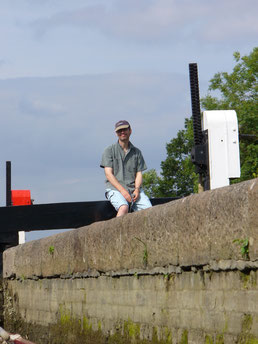 Husband hard at work operating the lock paddles and gates.