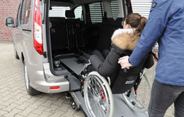 EasyPull winch and restraint system pulls wheelchair with occupant into a wheelchair accessible vehicle