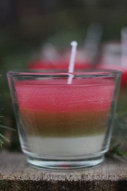bunte Duftkerze im Glas