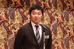 開会の挨拶 会員親睦委員長 L.上田桂輔