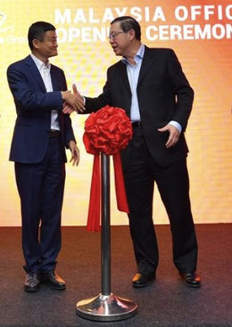 Handshake to celebrate Alibaba's office opening: Malaysia's Minister of Finance Lim Guan Eng (right) and Alibaba's executive chairman Jack Ma.